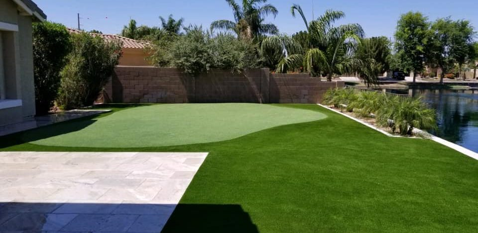 putting green on the lake with artificial grass