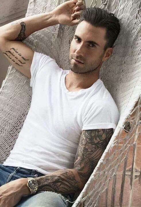 Adam levine favorite color food animal music bands sports for Adam levines tattoos