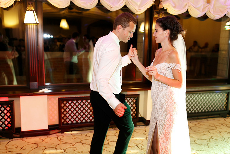 A bride and groom dancing at their wedding.
