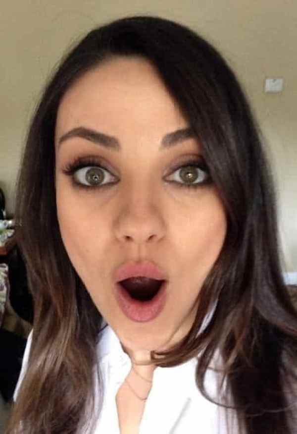 hot pic of mila kunis with her mouth open taking a selfie