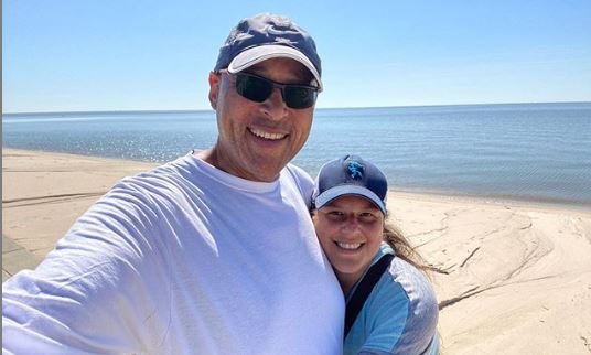 Kevin and his wife in a vacation