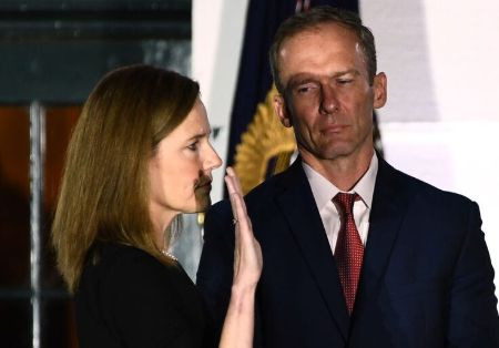 Amy Coney with her husband
