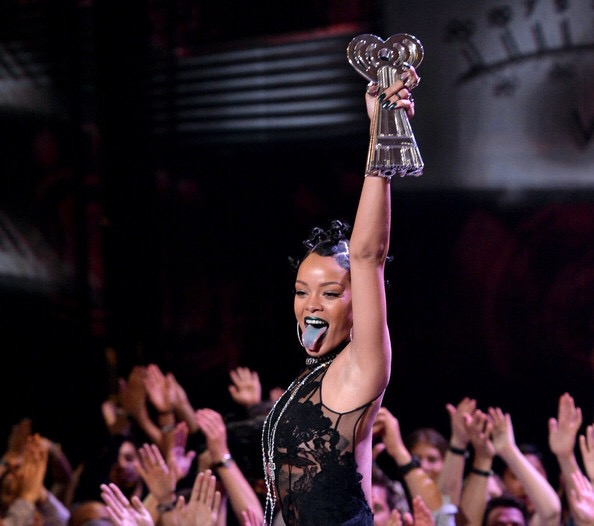 Rihanna accepting her award at the 2015 iHeartRadio Music Awards. (photo courtesy of: Kevin Winter/GettyImages)
