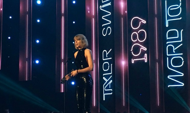 "Taylor Swift accepting her award for ""Best Tour"" at the 2016 iHeartRadio Music Awards. (photo courtesy: iHeartRadio)"