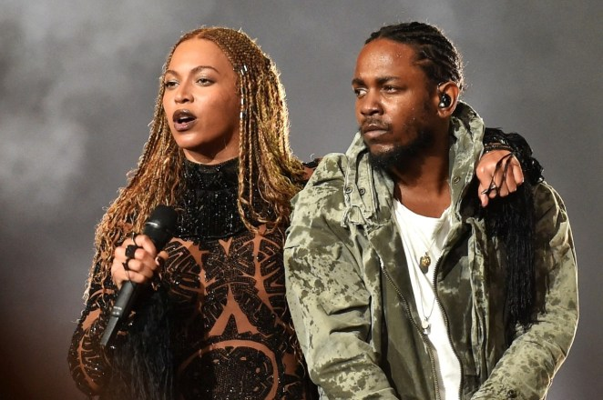 Beyonce and Kendrick Lamar on stage at the 2016 BET Awards. (Paras Griffin/BET/GettyImages)