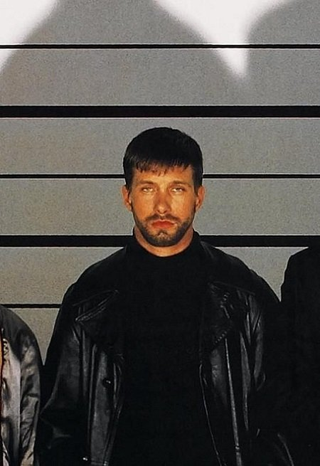 Stephen Baldwin standing in a criminal lineup as his role on 'The Usual Suspects'.