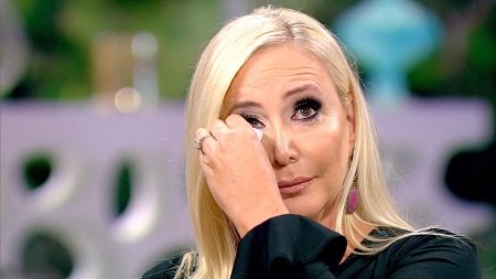 Shannon Beador rubbing the tears off her face.