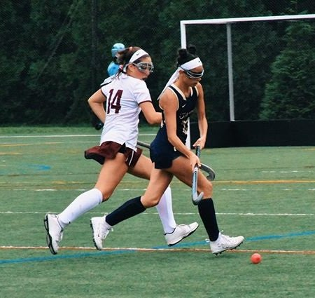 Dixie D'Amelio in action playing field hockey for the Vikings.