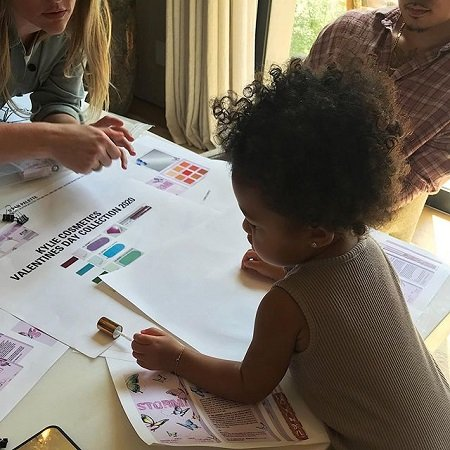 Stormi looking at sheet for the Valentine's Day collection.