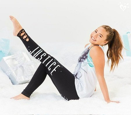 Mackenzie Ziegler posing for a leggins from Justice