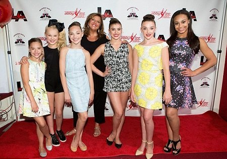 "Mackenzie Ziegler, Jojo Siwa, Maddie Ziegler, Abby Lee Miller, Kalani Hilliker, Kendall Vertesm and Nia Frazier attend ""Dance Moms"" Abby Lee Dance Company LA's VIP Grand Opening at Abby Lee Dance Company LA on May 30, 2015 in Santa Monica, California."