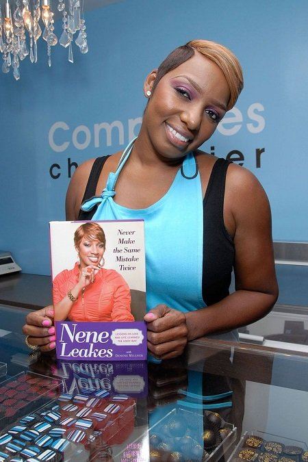 NeNe Leakes holding her book, 'Never Make the Same Mistake Twice'.