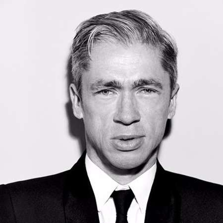 Mat Fraser in black and white photo with coat on