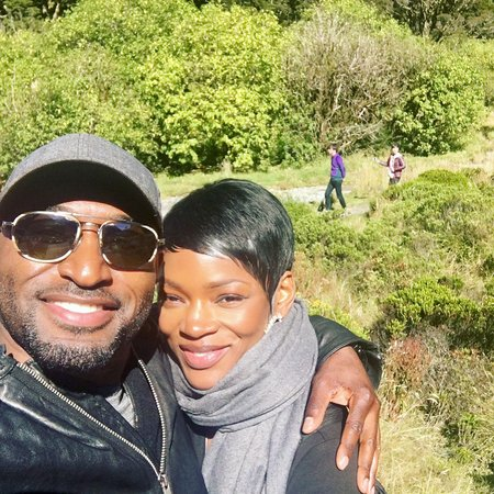 Adrian Holmes is married to his wife Caroline Chikezie.