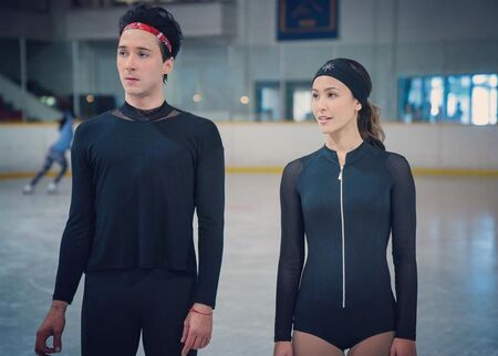"""Kaitlyn Leeb and Johnny Weir as Leah Starnes andGabriel """"Gabe"""" Richardson, respectively, in the Netflix ice skating series Spinning Out (2020)."""