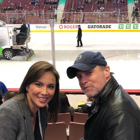 Michael Shanks and Lexa Doig watching their ice hockey team Vancouver Canucks at Rogers Arena.