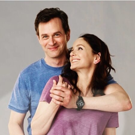 Tom Everett Scott and Sarah Wayne Callies as the husband and wife duo Scott Perry and Robin Perry, respectively, on the NBC drama Council of Dads.