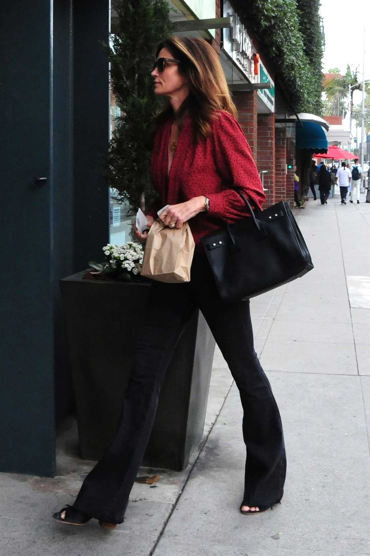 Cindy Crawford In A Red Blouse Was Seen Out In Beverly