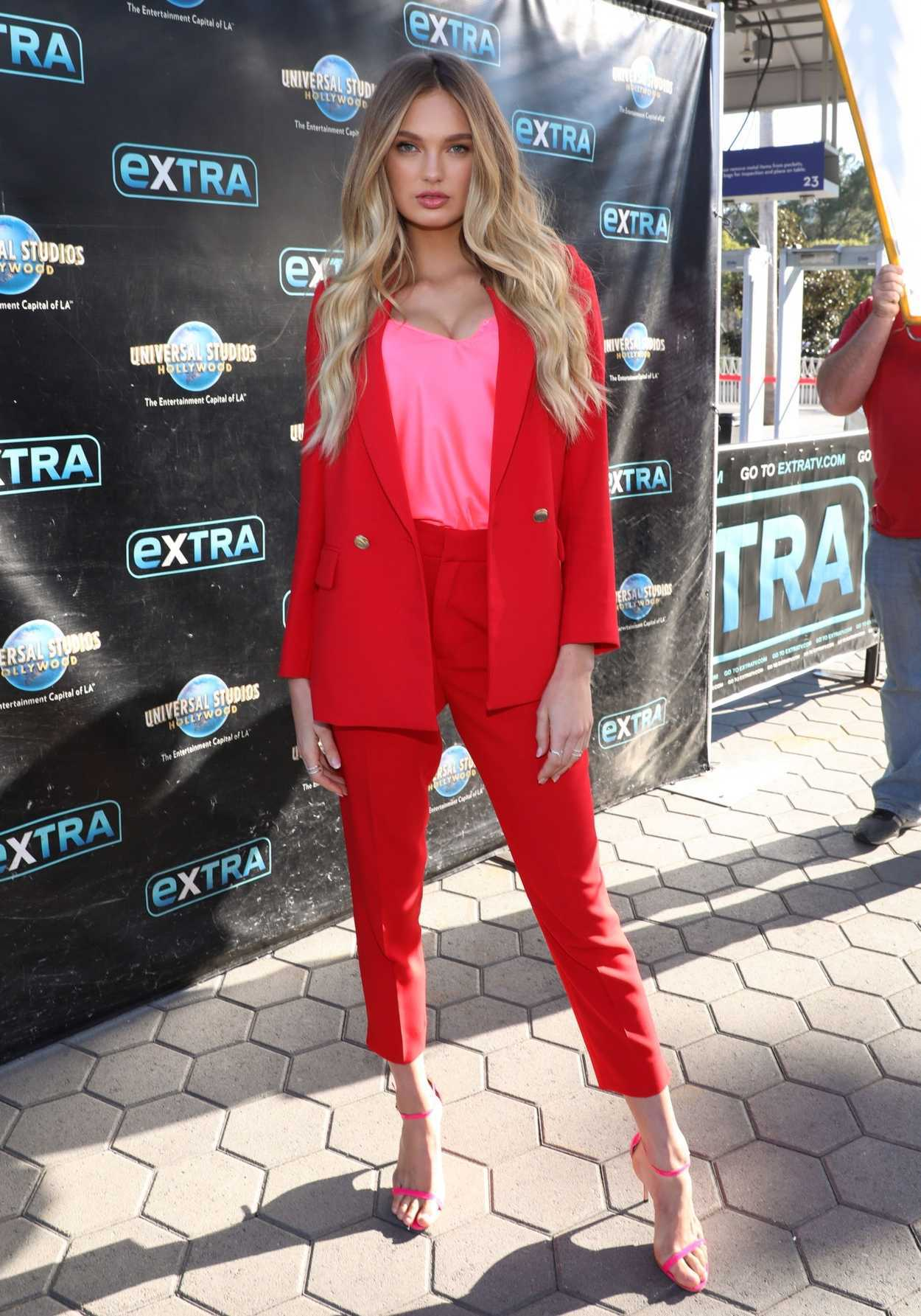 Romee Strijd in a Red Suit Arrives at Extra Show at