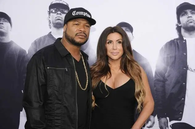 Rapper Xzibit L and Krista Joiner attend the Straight Outta Compton world premiere at L A Live on