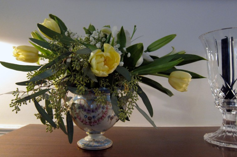 A special-occasion centerpiece with tulips and lilies