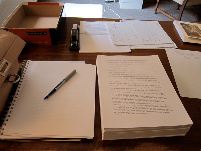 A thick manuscript on a desk