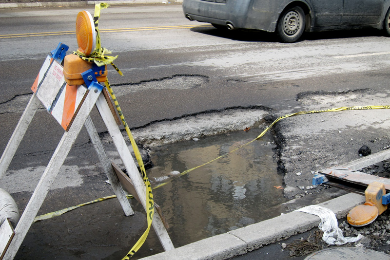 Chicago potholes look more like craters these days.