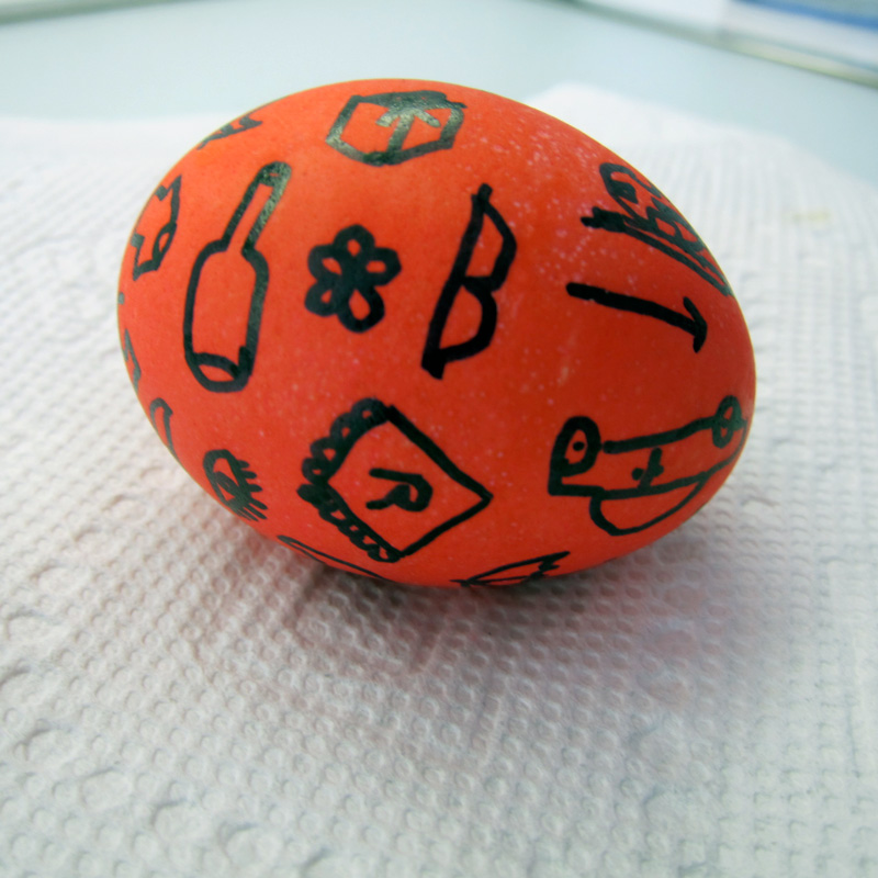Red easter egg with sharpie line drawings