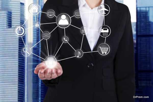 Midsection of businesswoman holding linked virtual icons in office