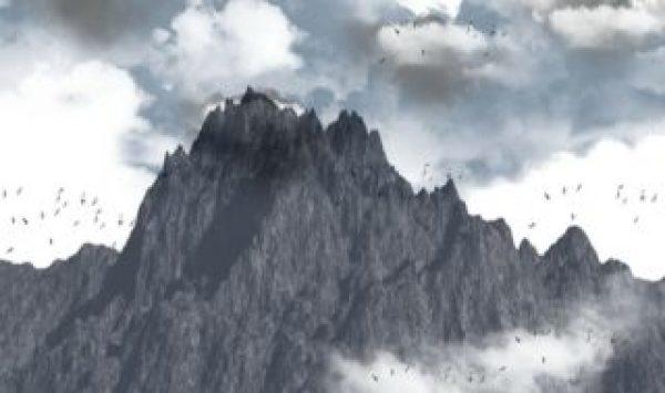 Es una gran montana con varios y alrededor estan volando muchas aguilas