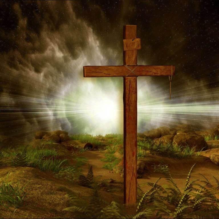 Es una cruz vacia y al fondo sale una luz brillante