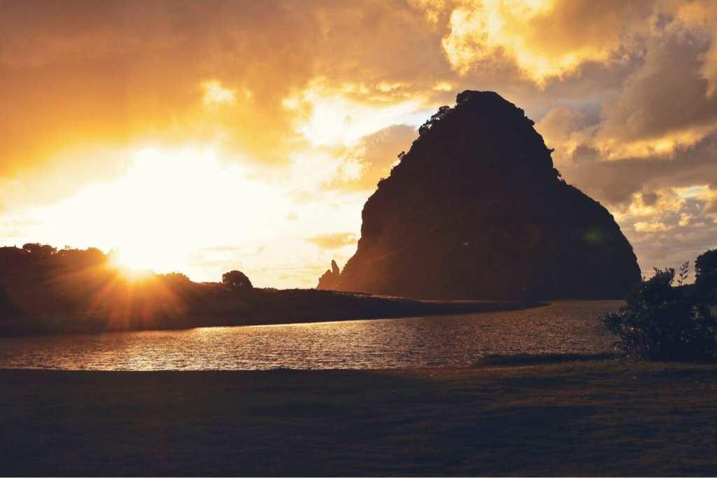 piha beach west coast auckland new zealand sunset