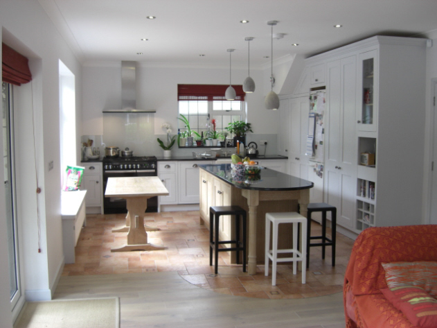 Traditional kitchen in North London with limed oak island