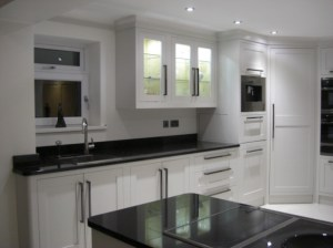 In frame painted Shaker kitchen in Aberdare by Celtica-Kitchens, designer Cameron Pyke; shows walk-in corner larder.