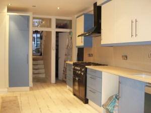 Blue & Ivory Slab Door Kitchen, Stainless Steel Accents, Tambour Door. Copyright Celtica Kitchens 2015