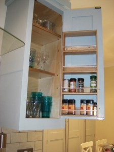 Duck Egg Blue Shaker Style Kitchen, Spice rack fitted to inside of wall cabinet door, storage solution Copyright Celtica Kitchens 2014