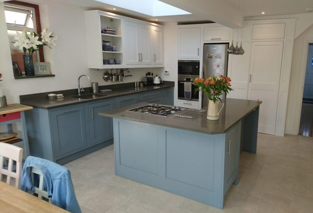 Bespoke kitchen in Wembley by Celtica Kitchens: L shaped island with inset hob