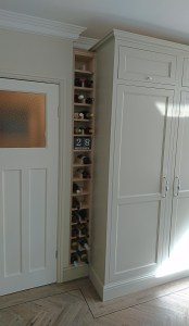 customer built winerack next to integrated separate fridge and freezer in tall cabinets by Celtica Kitchens