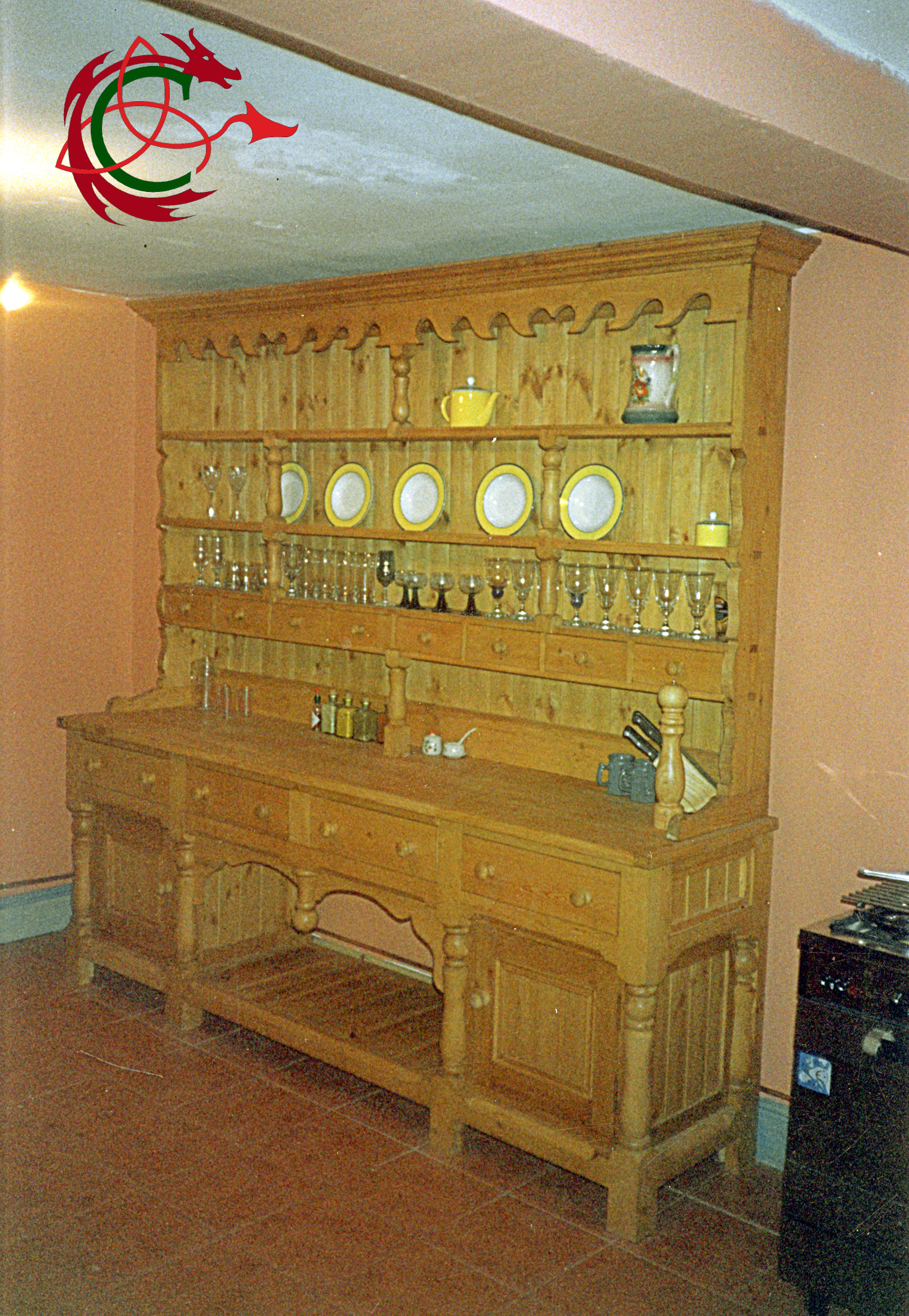 Large Welsh dresser with elaborate scrollwork, turned legs