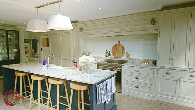 Edwardian kitchen with large overmantel, island with stools, granite worktop