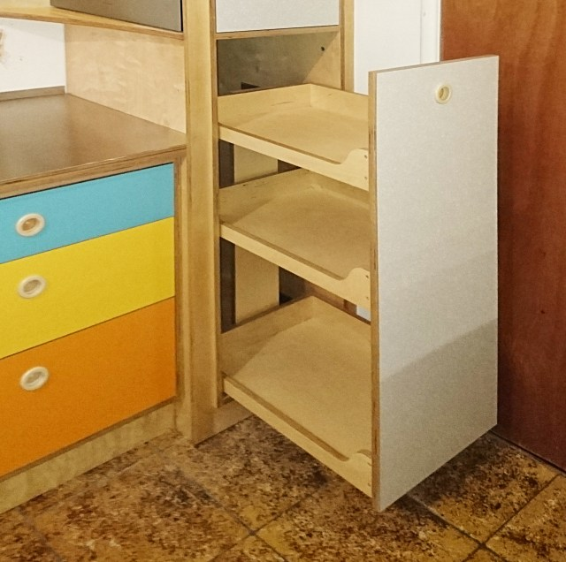 kitchen cabinet  pull-out storage in birch ply, laminated door, inset pull handles