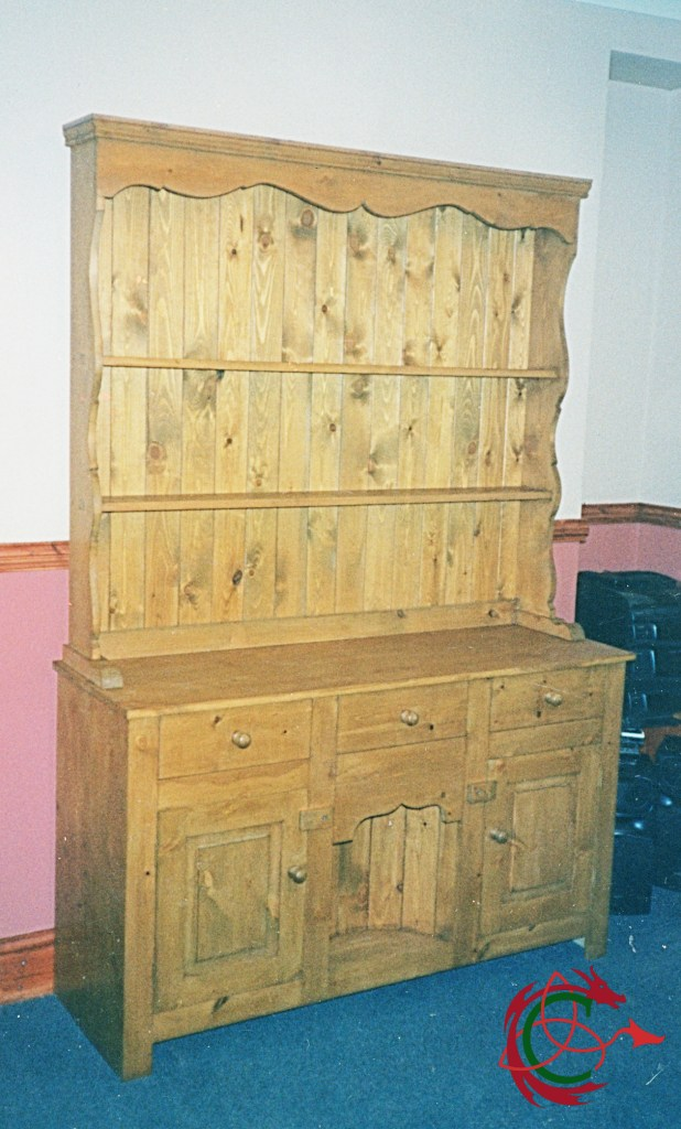 Small pine dresser with semi circular coop or niche in bottom centre.