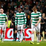 Scott Brown and Celtic players leave after PSG game
