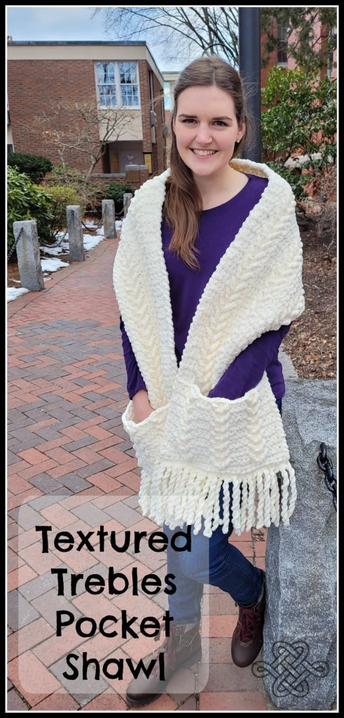 easy crochet pocket shawl in white with texture and fringe