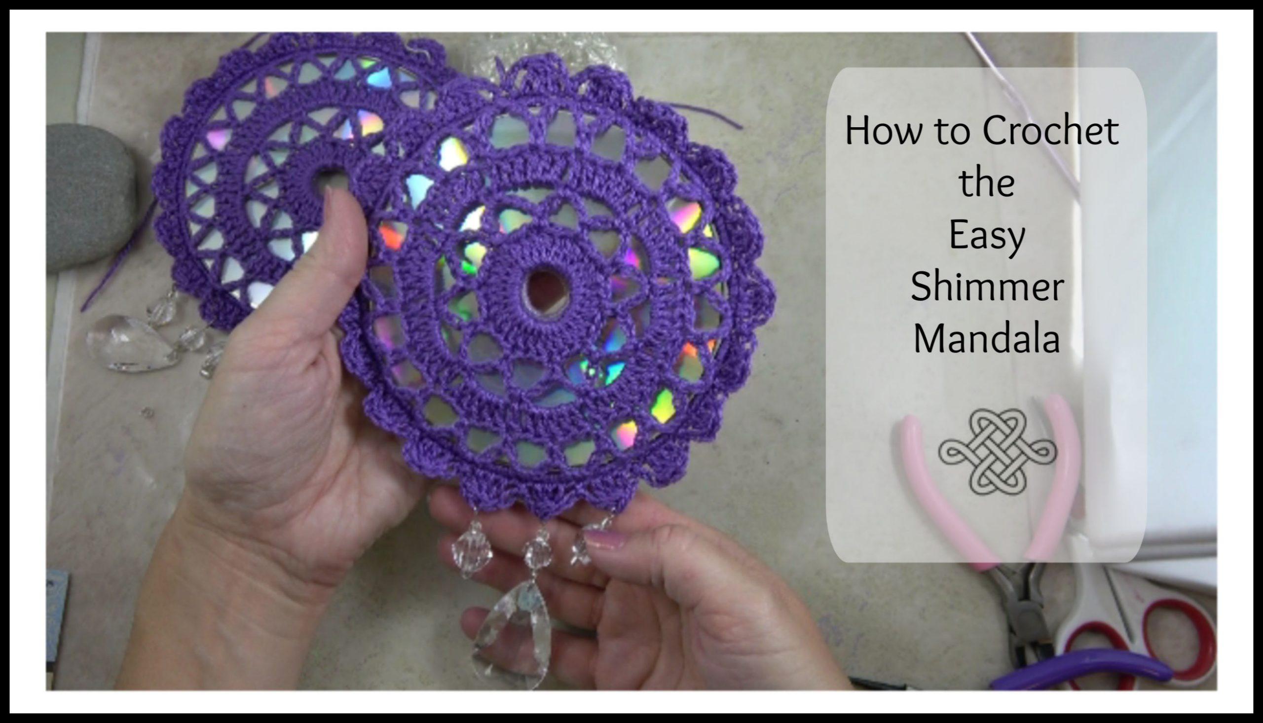 lacy crocheted mandala on a shimmery cd