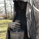 Shrouded figure holding an urn, Lake View Cemetery, Cleveland, Ohio