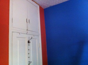 Southeast corner of The Nipper's room. Blue and adobe/brick.