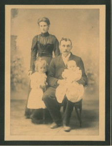 My great grandmother as a girl, standing with her parents.