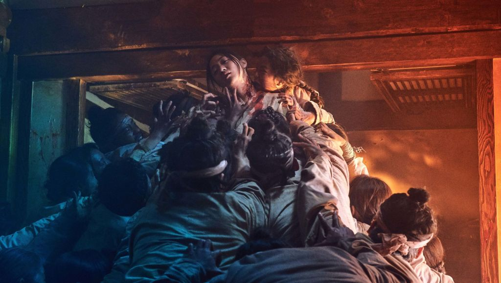 Kingdom Season 1 Promotional Image featuring a pile of zombies