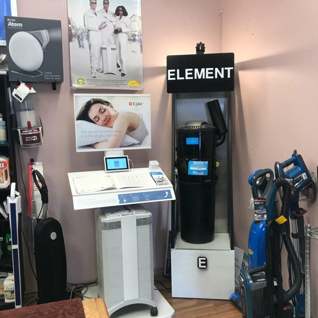 Centennial Vacuum showroom showcasing Element Central Vacuum canister